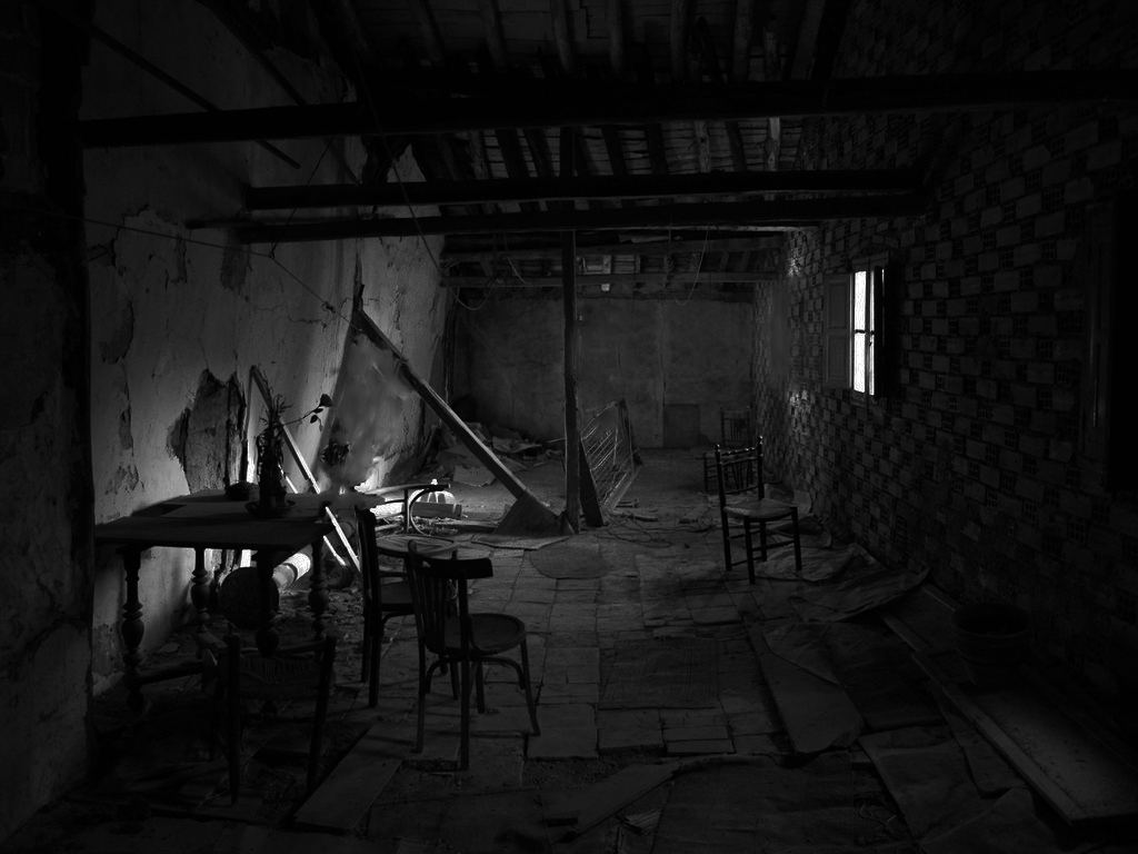 Inside abandoned house at night