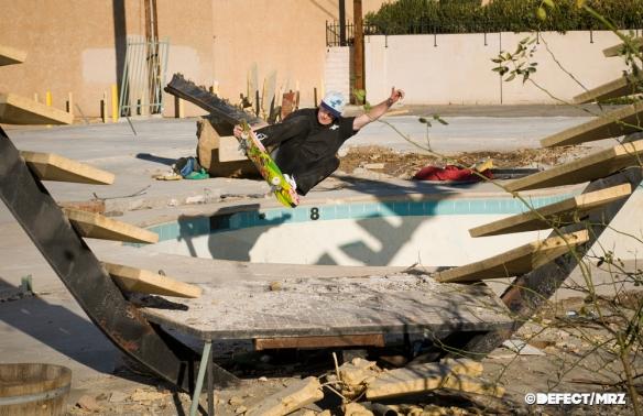 Josh Borden - hovers over the rubble