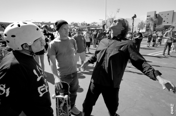 Dave Hackett giving pointers  to Steve Caballero.