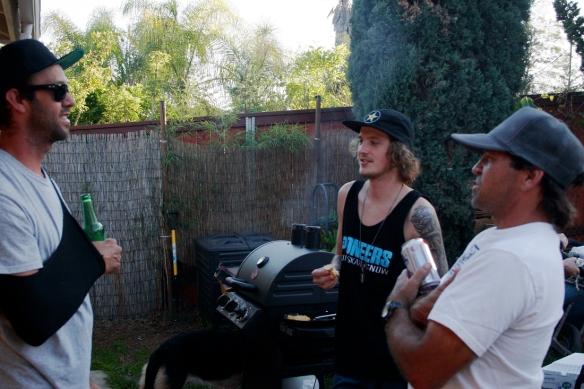 Bruno Passos, Nolan Munroe and Brad Edwards await the grub on the new grill
