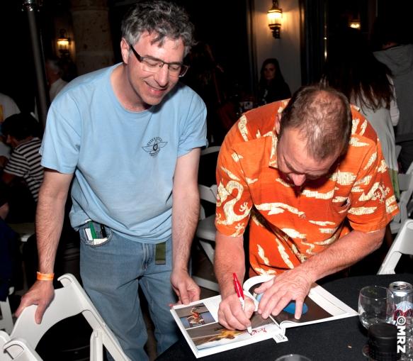 Gregg Weaver signing a fans Warren Bolster book